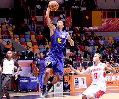 Rwanda's Kenneth Gasana scores against Tunisia. He is the top-scorer in the 2013 Afrobasket championship in Abidjan