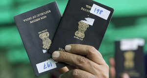 indian workers passport confiscated